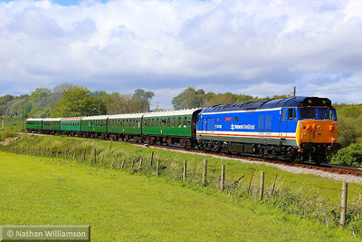 50026 heads south past Corfe Castle Foot Crossing on: 2S17 15:15 Norden to Swanage 11/05/14