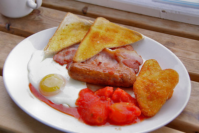 "Breakfast - Toast, 2 bacon, sausage, fried egg, 2 hash browns, tomatoes and tea. £6.30. Served in the ""Driftwood Cafe"" in Blue Anchor  15/06/12"