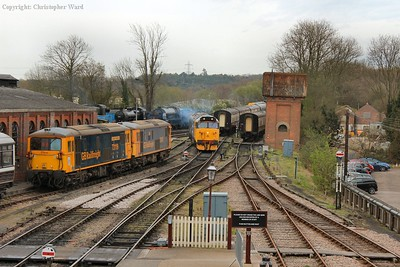 The 50 picks her way through the rather busy yard area and enters the station