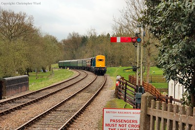 "With air-only 20205 leading dual-braked 20189, presenting a ""nose first"" 20 double header, the East Grinstead train enters Kingscote loop"