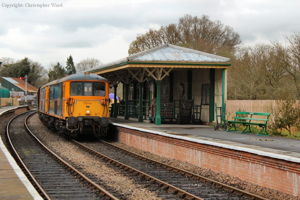73107 leads a train in