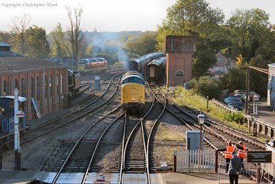 55019 shunts out of the yard and prepares to back onto her stock