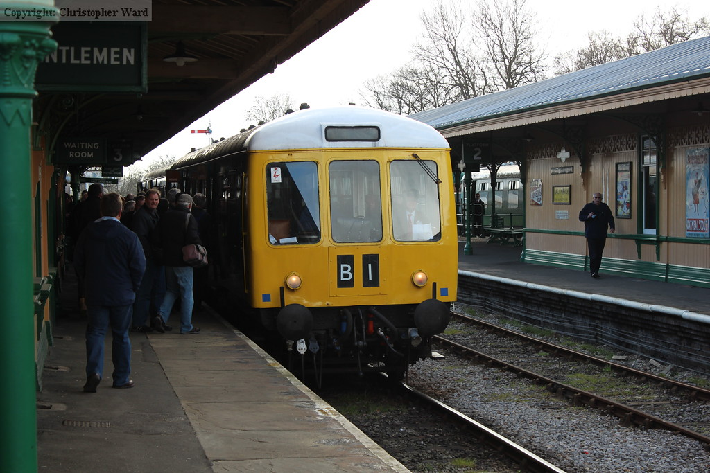 The DMU becomes a hive of activity as people board and alight