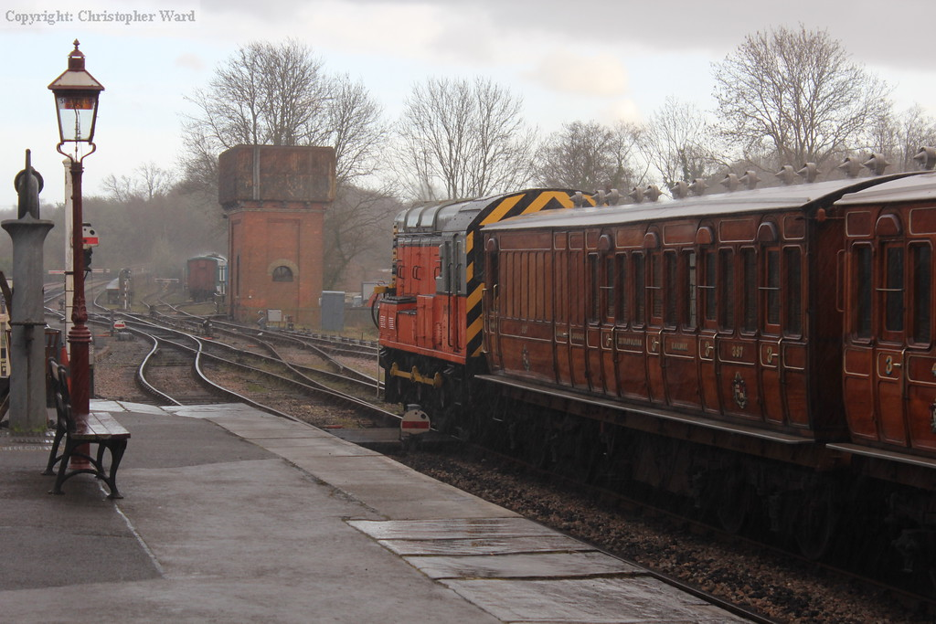A cloudburst over the station as the 09 brings the vintage train out of the shed and into the station