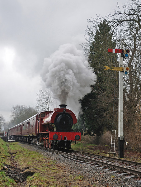 Mech Navvies pulls away from Church Street Crossing with a train for Rowsley