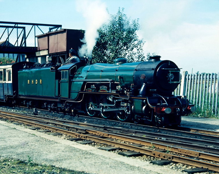 No 7 Typhoon pictured at Dymchurch in August 1954.  This locomotive received smoke deflectors in 1955.  The shot is taken on Ferraniacolour which doesn't seem to quite capture the green of Typhoon.