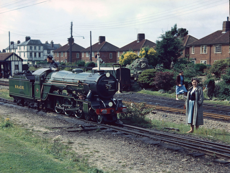 No 2 Northern Chief captured just a few moments earlier moving towards New Romney shed in slightly better light in August 1954.   The shot includes my mother, Kay, on the right.  My mother was always very patient over father's obsession with steam engines.