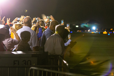 Supporters of President Donald Trump wave, cheer and take photos Air Force One lands at Palm Beach International Airport in West Palm Beach on Friday, February 14, 2020. [JOSEPH FORZANO/palmbeachpost.com]