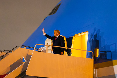 President Donald Trump waves to his supporters as he exits Air Force One at Palm Beach International Airport in West Palm Beach on Friday, February 14, 2020. [JOSEPH FORZANO/palmbeachpost.com]