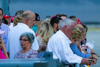 Supporters of President Donald Trump await the arrival of Air Force One on the tarmac at Atlantic Aviation at Palm Beach International Airport in West Palm Beach on Friday, February 14, 2020. [JOSEPH FORZANO/palmbeachpost.com]
