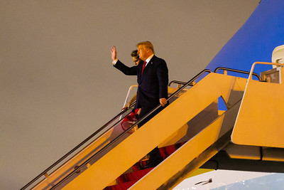 President Donald Trump and wife Melania descend the stairs from  Air Force One at Palm Beach International Airport in West Palm Beach on Friday, February 14, 2020. [JOSEPH FORZANO/palmbeachpost.com]