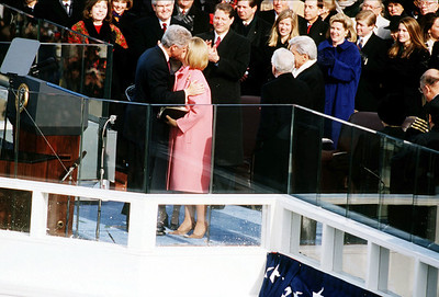 President William Jefferson Clinton and First Lady Hillary kiss at the West Front of the Capitol following the 1997 Presidential Inaugural Swearing-in Ceremony.  The National Archive / Unwritten Record Blog https://unwritten-record.blogs.archives.gov/2017/01/10/a-look-at-inauguration-day-through-the-years-inaugural-photographs-and-facts/