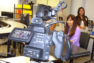 Sonya Christian checks out robots.