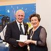Lady Captain Miriam receiving the Winner of Ladies 9-Hole Competition from President Colm on behalf of Angela Garland