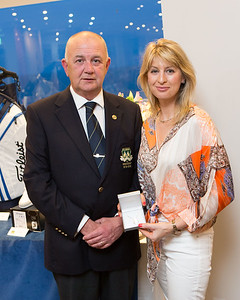 Ruth Marie, Runner-Up (Ladies 9-Hole Competition) in the President's Prize, receiving her prize from President Colm