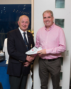 Ciaran Lally, Gross Prize Winner in the President's Prize receives his prize from President Colm