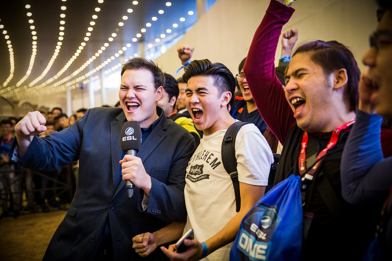 Roaming Host Jake 'Siractionslacks' Kanner cheering with fans in the arena lobby