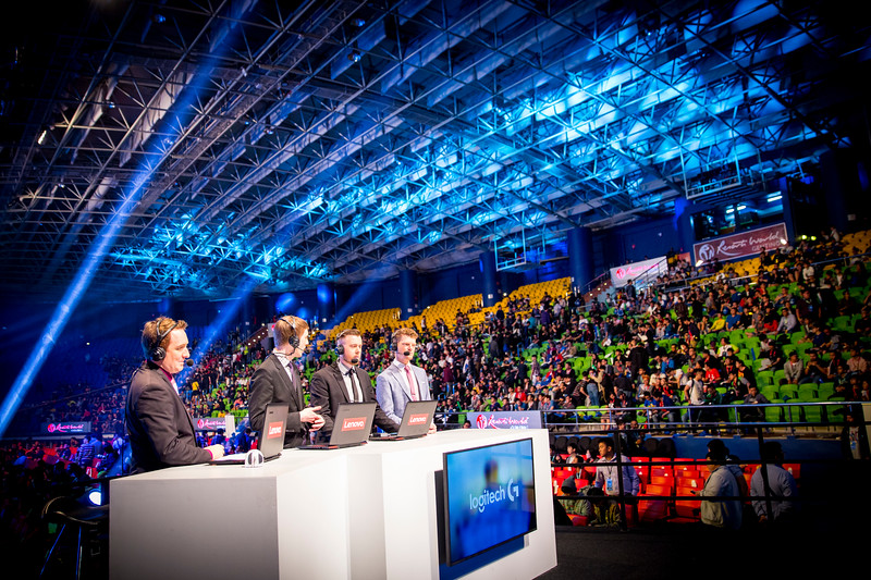 The analyst desk discussing the games in front of the crowd