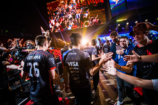 Players of SK gaming and Faze Clan get greeted by fans as the enter the stage to play in the finals