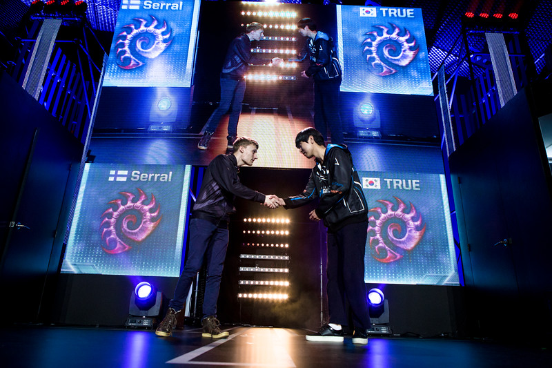 Serral and True shaking hands before their match