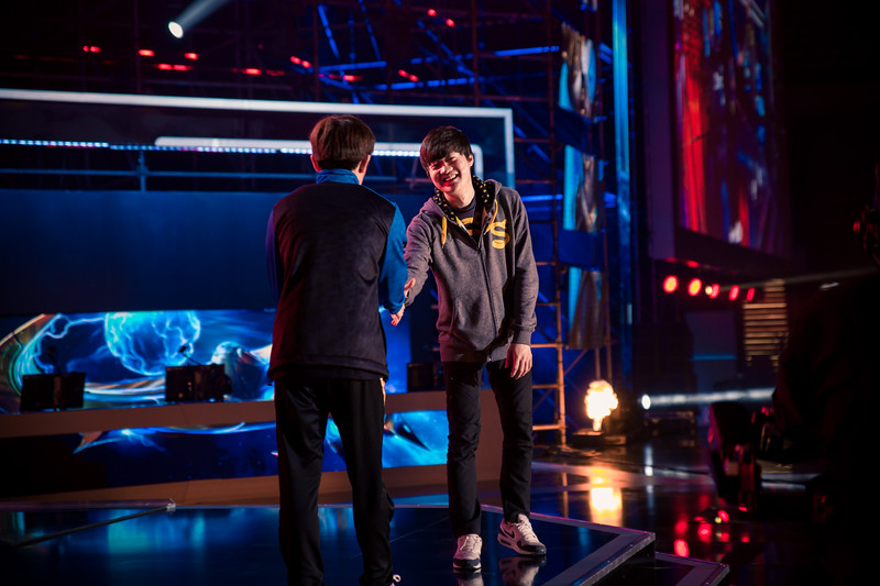 Stats and TY shaking hands