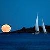 A full moon rises behind Wood Island in Biddeford