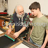 MDEP-10-02-2018-012 Marco Rayment demonstrates Screen Printing to local student Theo Sloos in his workshop