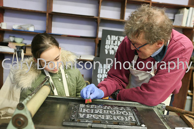MDEP-10-02-2018-005 8 year old Evie Wilkinson from Spooner Row gets tuition from local block printer John Harding