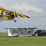 MDEP-30-07-2017-009 Old Buckenham Airshow, TV presenter and Flying legend Brendan O'Brien lands his Piper Cub on a trailer at 60MPH.