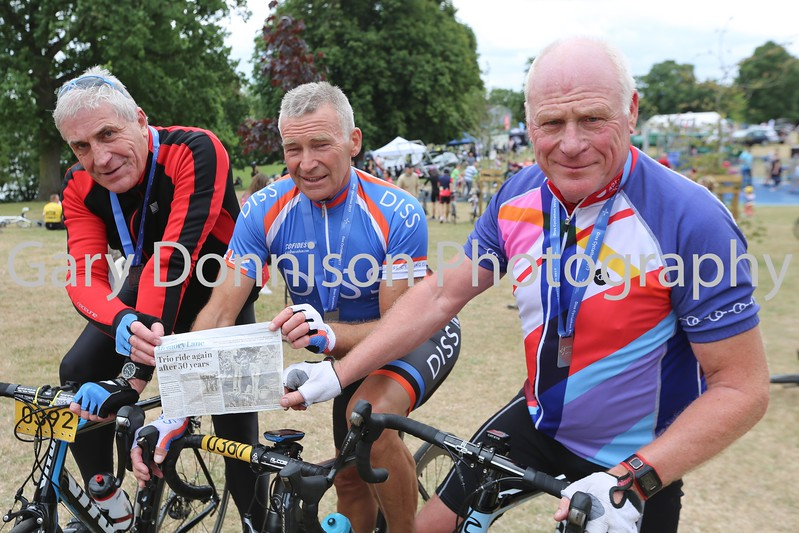 MDEP-25-06-2017-044 Diss Cyclathon 25th June 2017. Malcolm Chambers, Robin Briscoe and Graham Trudgill with a copy of their original Photograph taken 50 years ago