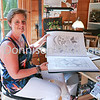 "MDEP-05-07-2017-005 Artist Karen Harper with Art from her new adult colouring book ""Spring Secret"""