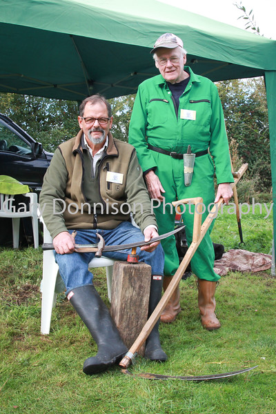 MDEP-08-10-2016-033 Diss Community Woodland Open Day Quaker Wood Mike Garnham & Teddy Rowley demonstrate working with a Scythe