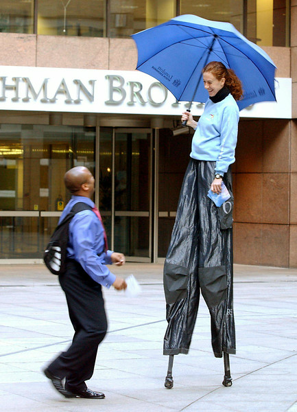 London Stock Exchange launches Covered Warrants in the City today.<br /> <br /> Stilt walkers hand out leaflets to city workers promoting the launch of Covered Warrants at Broadgate Circle.<br /> <br /> Picture by Jeff Jones