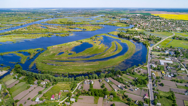 An aerial photo of the River Pripyat, the town Turov and its surrounding floodplain meadows, wetlands and oxbow lakes. This is an extremely important site for migrating birds (mainly waders) who stop here to feed on the abundance of food before continuing their migration. Turov area, Polesie, Belarus. © Daniel Rosengren