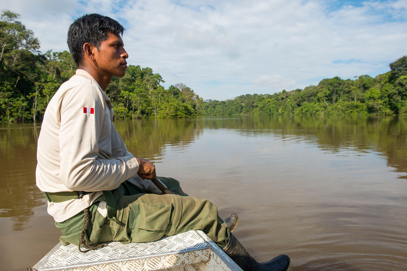 A park ranger in the front of the boat on the River Yaguas, Peru. © Daniel Rosengren
