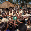 A COCOBA group holding the box after the annual cash payout meeting in Katibunga, Zambia. COCOBA (Community Conservation Bank) is a micro finance system taught by FZS where small local groups invest money in the bank. They can also borrow money with interest for startup or equipment investments in eco-friendly businesses. Each year, investors in the bank get a share related to their investment out of the profit of the bank. © Daniel Rosengren.