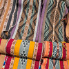 Scarfs of alpaca wool woven by women. They are a part of the Asociacion de Madres Tejedores, a project teaches women to weave and that way help them be able to support themselves and make a living by also teaching the to run a business. Each region has their own specific pattern. Patanmarca, Peru. © Daniel Rosengren
