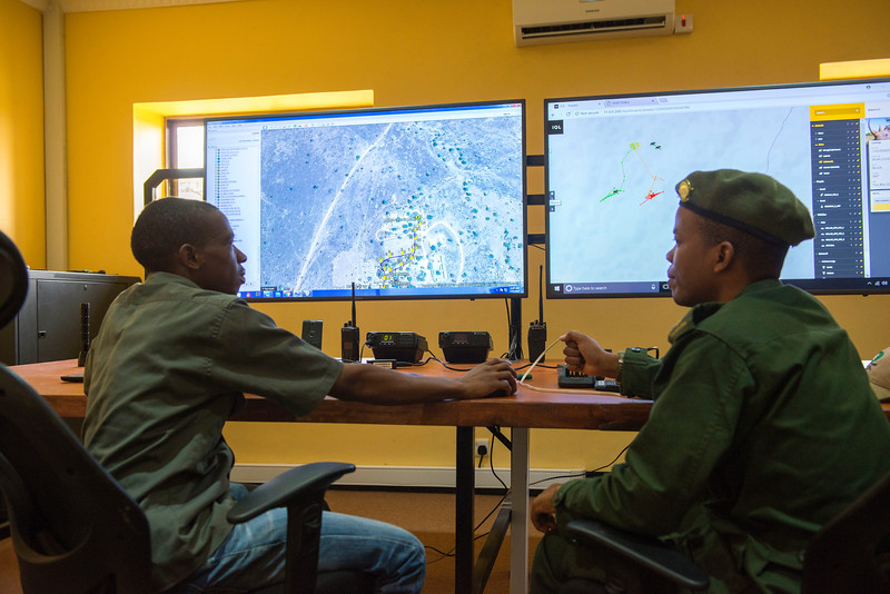 Gerald Ernest Nyaffi (Radio and IT Technician at FZS, left) and Ramadhani Bakari Hamisi (TANAPA, Park Warden for the Control Room and soon to be Pilot) in the Control Room building, From here rhinos will be monitored, rangers directed and potentially tourism cars monitored for off-roading and speeding etc. Seronera, Serengeti, Tanzania. © Daniel Rosengren