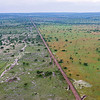 The border between the Serengeti Ecosystem and the cultural landscape outside is very clear and visible from a plane. This photo is taken just after some a rain shower. It is obvious that the protected area absorbed the water well, keeping it in the system. On the side affected by human activities, it is very clear that the water doesn't get absorbed properly, nutrients are flushed away as the water runs off. Moreover, when the dry season comes, the human affected areas are likely to have less ground water and more likely to suffer from droughts. Ikorongo Game Reserve, Tanzania. © Daniel Rosengren / FZS