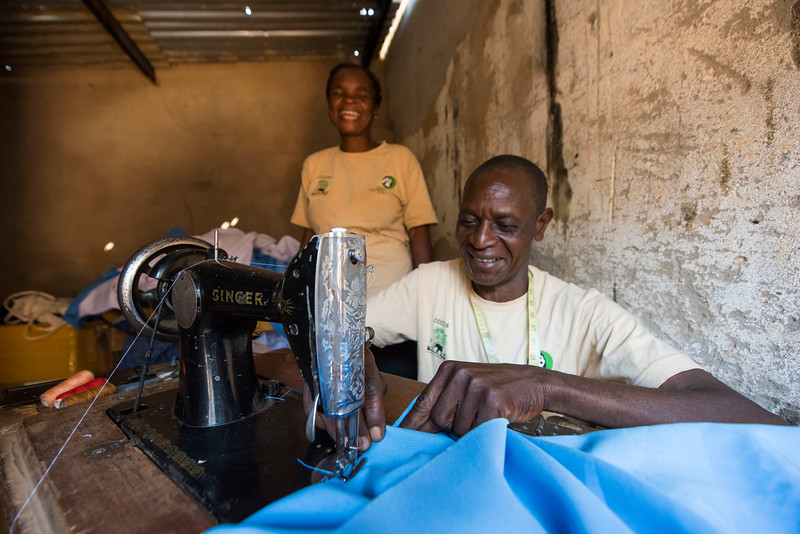 A man from a COCOBA group in Katibunga, Zambia. COCOBA enabled him to borrow money to start up a very successful tailoring business and he is very thankful for COCOBA to give him this chance to change his life. Near North Luangwa National Park, Zambia. © Daniel Rosengren / FZS