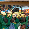 Children at the Makhosiya Primary School, Chiredzi greeting the Chilojo Club Education Programme car with the teacher, Ezekia Chauke, in it. Near Gonarezhou NP, Zimbabwe. FZS teach children around the park about nature and conservation. © Daniel Rosengren / FZS