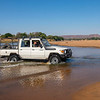 The FZS / Gonarezhou Conservation Trust car crossing the River Runde. Gonarezhou National Park, Zimbabwe. © Daniel Rosengren / FZS