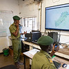 Rangers working in the control room. From this room it is possible to keep track of collared elephants, rangers on patrol, vehicles and much more. Gonarezhou National Park, Zimbabwe. © Daniel Rosengren / FZS