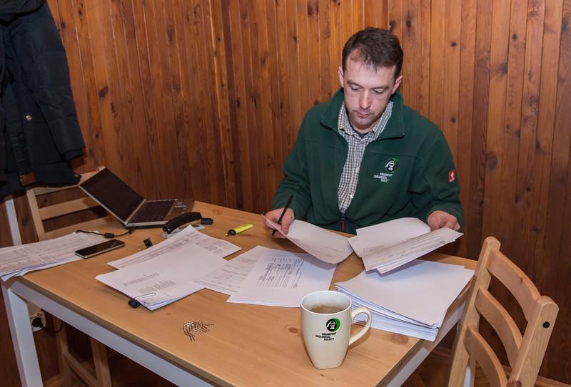 Project leader Viktar Fenchuk at the desk in the FZS office. Bialowieza National Park, Belarus. © Daniel Rosengren / FZS