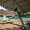 Rian Labuschagne (FZS Serengeti Programme Manager) and Ramadhani Bakari Hamisi (TANAPA, Park Warden for the Control Room and soon to be Pilot) preparing the FZS plane for takeoff. Seronera, Serengeti NP, Tanzania. © Daniel Rosengren