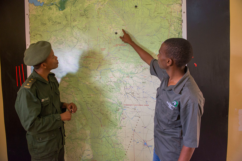 Gerald Ernest Nyaffi (Radio and IT Technician at FZS, right) and Ramadhani Bakari Hamisi (TANAPA, Park Warden for the Control Room and soon to be Pilot) looking at a map in the Control Room building. From here rhinos will be monitored, rangers directed and potentially tourism cars monitored for off-roading and speeding etc. Seronera, Serengeti, Tanzania. © Daniel Rosengren