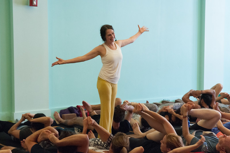 Sharon Gannon encouraging students during a difficult sequence in her yoga class at Jivamukti Yoga School in New York City. Photo by Derek Pashupa Goodwin.