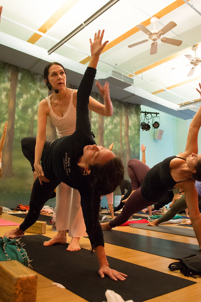 Sharon Gannon assisting a student during her yoga class at Jivamukti Yoga School in New York City. Photo by Derek Pashupa Goodwin.