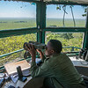 A Moru ranger, Eliapenda Michael Mollah, sitting in an observation tower and keeping track of the rhinos as well as looking out for poachers. Moru, Serengeti, Tanzania. © Daniel Rosengren