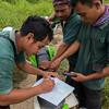The wildlife Protection Unit (from left: Adi Octaperi, Mardani and Sanusi) taking data in the field near Bukit Tigapuluh, Sumatra, Indonesia. © Daniel Rosengren